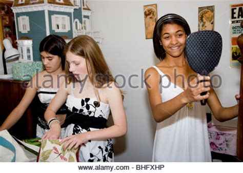 girl dancing in bathroom 8th grade girls preparing for their formal dance at their
