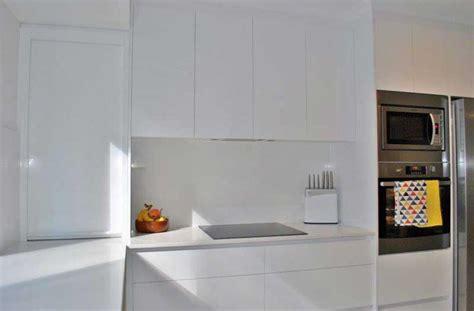 Sleek, all white handleless kitchen renovation
