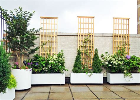Roof Garden Planters by Nyc Roof Garden White Planters Terrace Deck Paver Patio