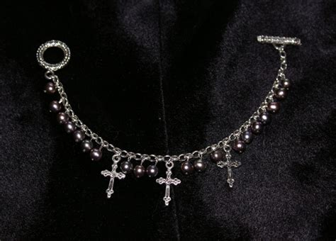 pearl and cross charm bracelet by nixxxi on deviantart