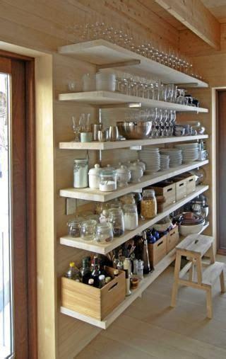 big floor  ceiling kitchen shelves open pantry