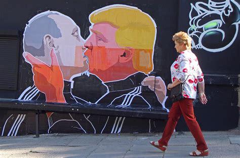 trump putin share kiss  lithuanian mural artnet news