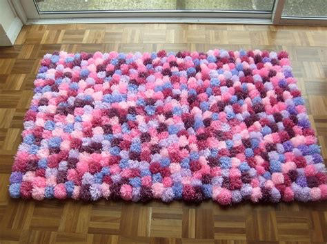 how to make a yarn pom pom rug 1000 images about pom poms on table covers yarns and rope rug