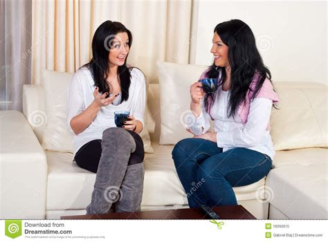 people having on a couch two friends women conversation home stock image image