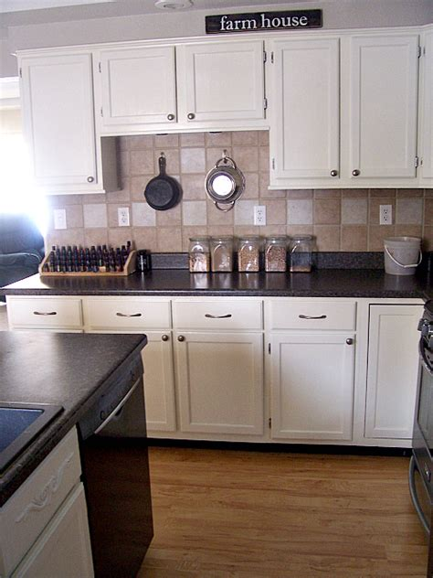can you paint kitchen cabinets spray painted cabinets free kitchen cabients taped for