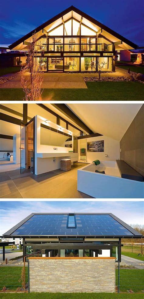 fachwerkhaus modern fassade glas photovoltaik dach