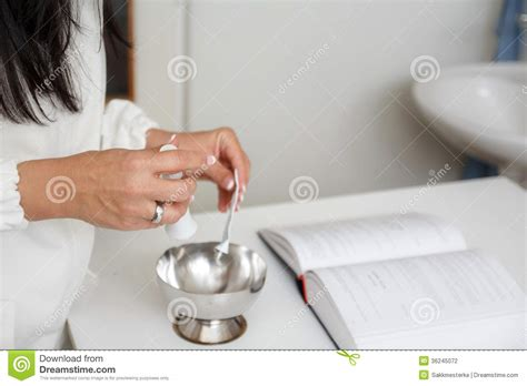 How To Prepare To Be A Pharmacist by Pharmacist Prepare Mixture In Mortar Stock Photography