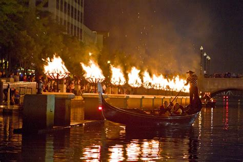 boat basin of waterplace park waterfire lights up the urban setting in providence