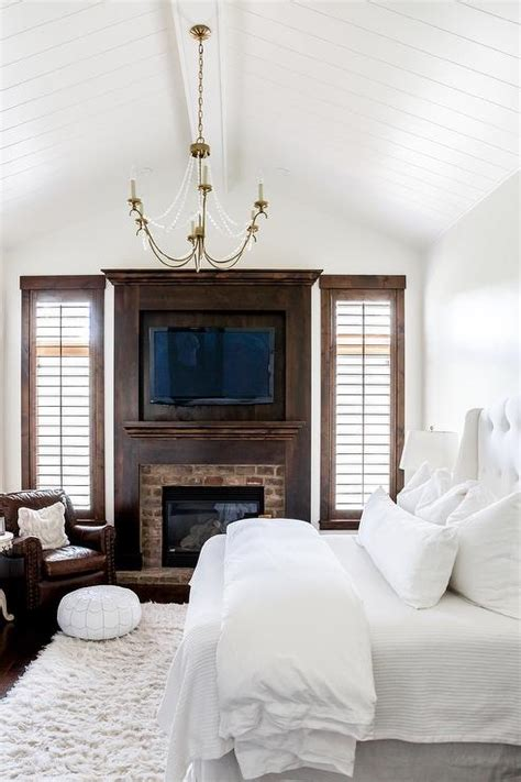 white bedroom  dark stained wood trim transitional bedroom