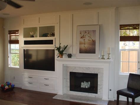 Built In Wall Units With Fireplace by Built In White Entertainment Center Next To Fireplace