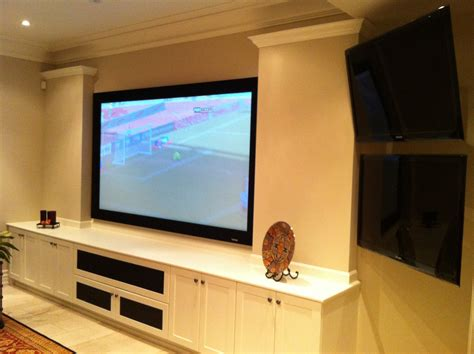 projection system with custom built audio furniture