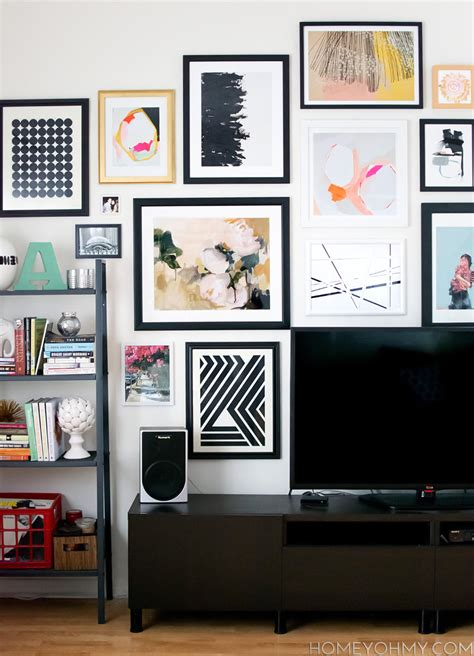 art on wall how to plan and hang a gallery wall homey oh my