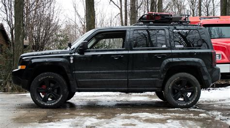 lifted jeep patriot lifted jeep patriot 235 65r17 cooper discoverer at3 tires