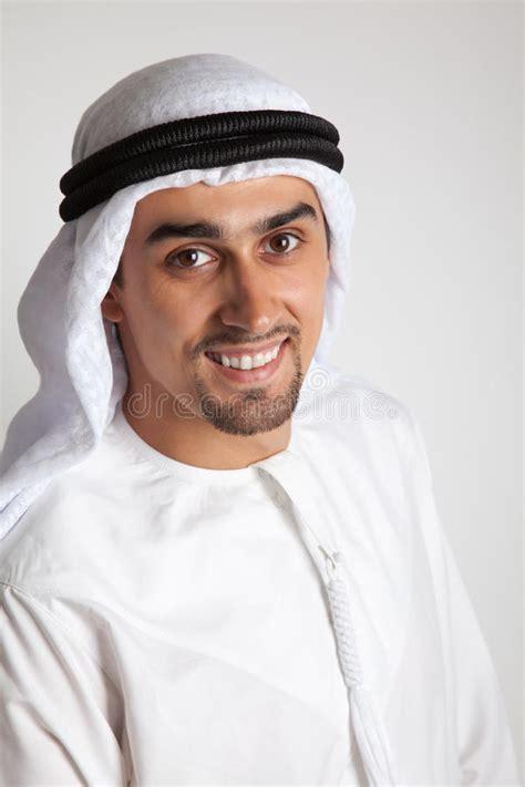 arabian muslim man  beard holding  holy book quran