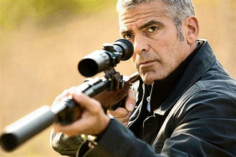 The American George Clooney As Aims His Lovingly Crafted Weapon In The American