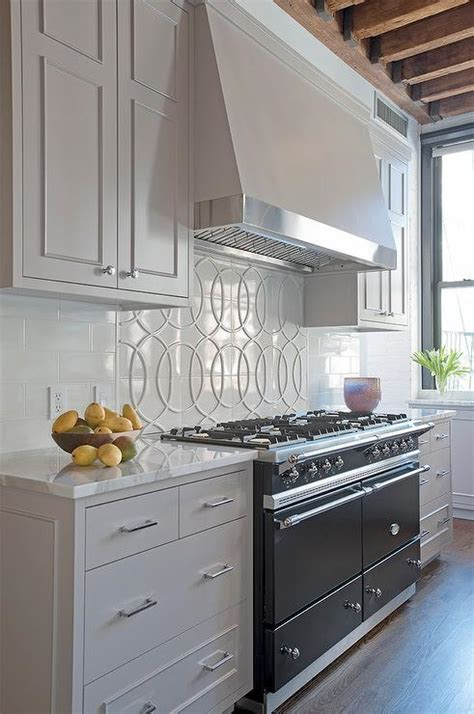 Light Gray Cabinets by Light Gray Kitchen Cabinets With Black Lacanche Range