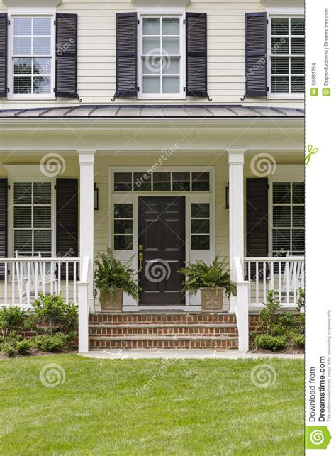 red house with a porch photograph by les palenik white colonial house porch and plants stock photo image