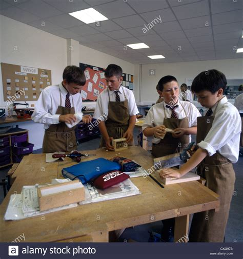 high school woodwork class students working  bench boy