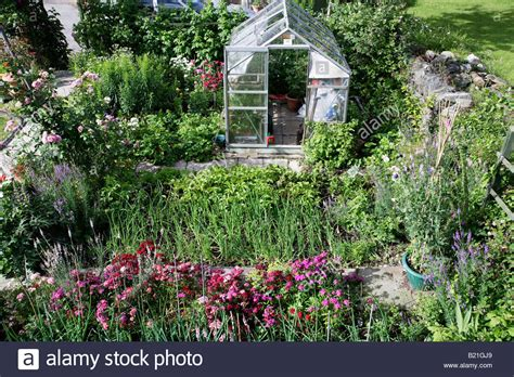 flower and vegetable garden cottage garden with greenhouse flowers and vegetables