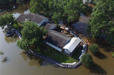 texas man  massive inflatable dam  save house
