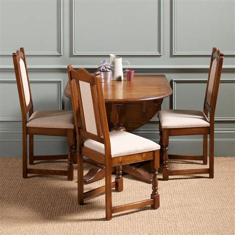 Small Space Dining Table And Chairs Antique Drop Leaf Dining Table For Small Dining Room Spaces And 3 Wood Dining Chairs With White