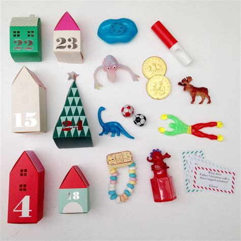 3d village advent calendar with treats for boys by little lulubel   notonthehighstreet.com