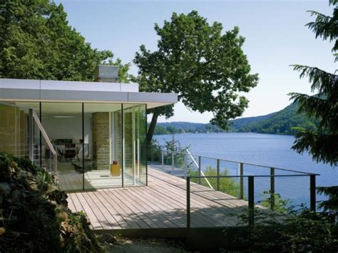 beside lake modern wooden house design olpos design modern german house clad in glass offers unabated lake views