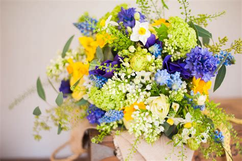 Wildflower Arrangements by Bristol Wedding Flowers Spring Yellow And Blue Wedding