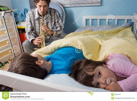 putting kids to bed father and children royalty free stock photos image 5252118