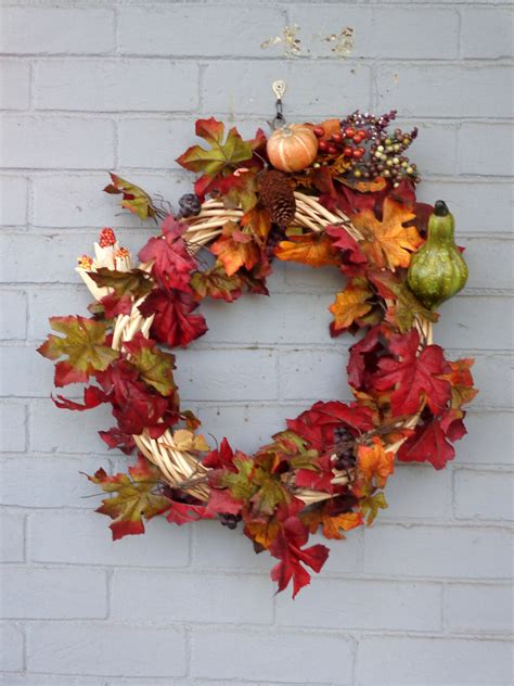 autumn wreath autumn wreath with gourdes berries and fall leaves picture