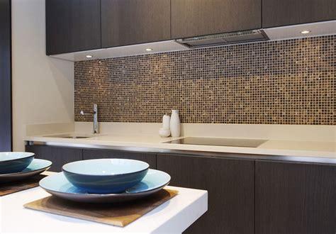 Luxury Kitchen featuring Emperador Marble mosaic splash back Contemporary Kitchen london