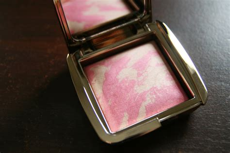 giving cheeks a luminous flush with hourglass ambient