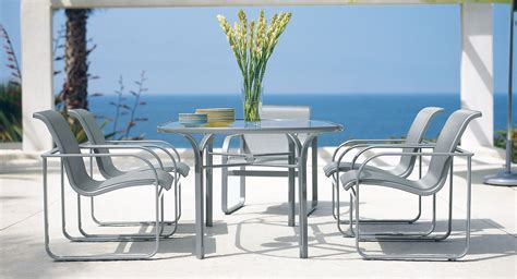 patio furniture brown grey chairs and glass top table in appealing dining space