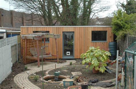 Cedar Clad Garage Doors by Cedar Clad Concrete Garage Home Decor