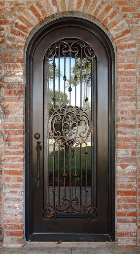 Iron Gates For Front Doors 1000 Ideas About Iron Doors On Wrought Iron Doors Wrought Iron And Brass Door Knocker