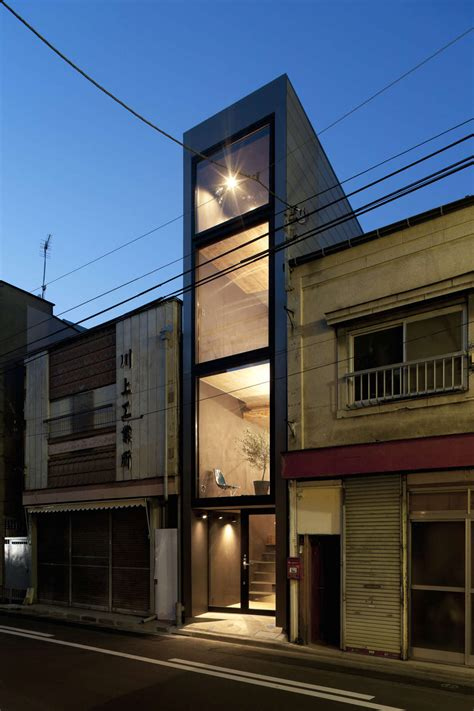 narrow house long and narrow house squeezed between two buildings