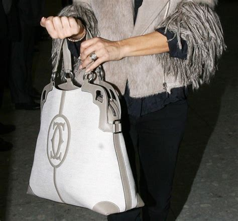 Name The Bag Fergie by Fergie In The Marcello De Cartier Shopping Bag