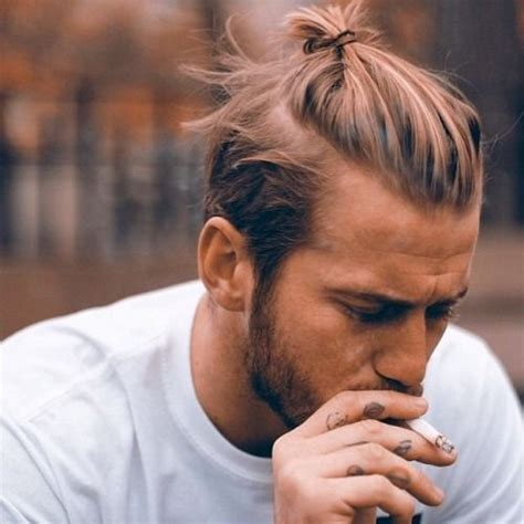 messy bun without shaved side showing 36 best haircuts for men 2017 top trends from milan usa uk