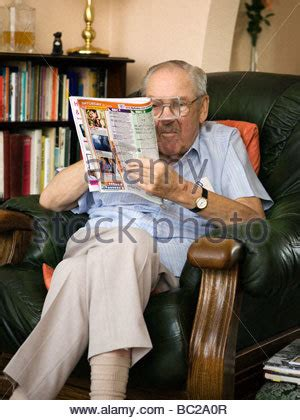 hold you in his armchair old man sits in his favourite armchair resting his head