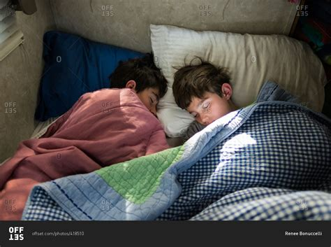 teen boys sleeping in bed together two teen boys asleep in a bed stock photo offset