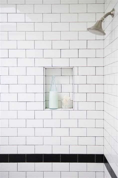 white bathroom tiles with black grout white subway tiles black grout niche toilet pinterest