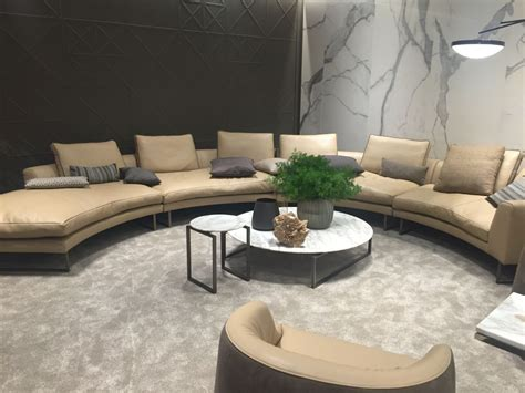 Curved Sofa Tables Curved Leather Sofa And Circle Coffee Tables Home Decorating Trends Homedit