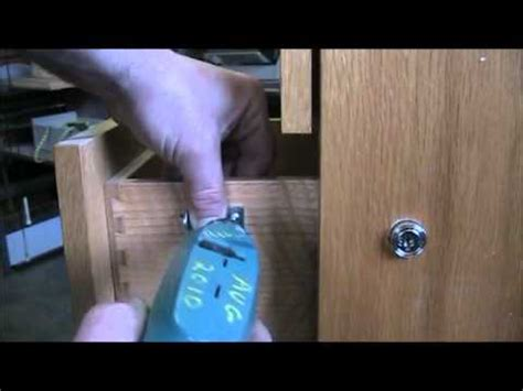 How To Put A Lock On A Drawer by Install Simple Plunger Lock On Wood Drawer Of Filing