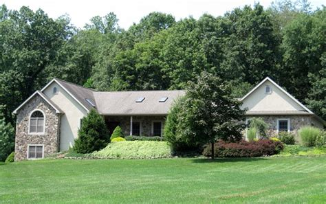 house auctions pa english style ranch home w attached 3 car garage carriage house and pond on 8 96