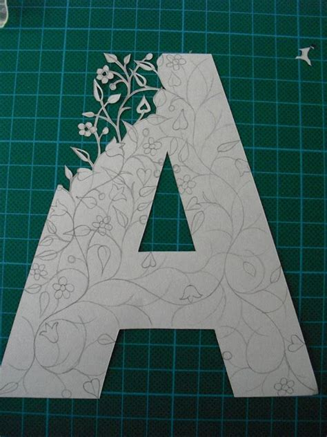 pattern design letter paper cut initials so pretty and tedious looking