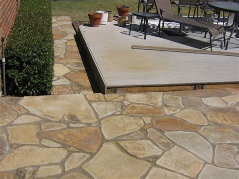 flagstone patio with walkway home and lawn transformers