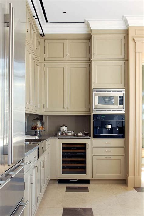 Beige Kitchen Cabinets Beige Kitchen Countertops Stainless Steel Appliances And Beige Painted Cabinets Create A
