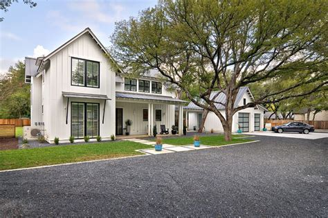 modern farmhouse exterior farmhouse with gravel driveway modern farmhouse exterior farmhouse with white house