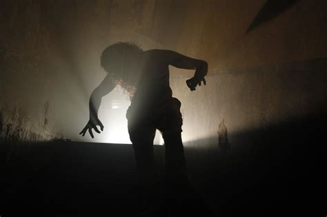 scare house behind the thrills scarehouse takes you into the basement where your darkest fears
