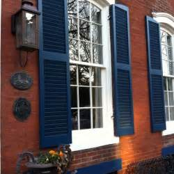 shutter colors for brick house royal blue shutters on brick exterior this could be a